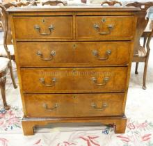 ANTIQUE CHEST OF DRAWERS. 2 OVER 3. BANDED DRAWERS & TOP. BRACKET FEET. 34 IN WIDE. 41 IN TALL.