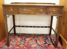 ANTIQUE CHIPPENDALE STYLE 3 DRAWER DESK. FRETWORK CORNERS, CARVED CORNER PANELS, AND A GALLERY. 36 IN WIDE. 29 IN HIGH.
