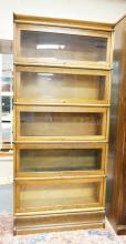 5 SECTION OAK STACKING BARRISTER BOOKCASE. 75 IN TALL. 35 IN WIDE.