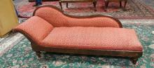 CHAISE LOUNGE WITH RED & WHITE UPHOLSTERY & TURNED FEET. 70 IN LONG.