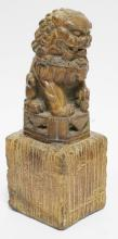 CARVED STONE FOO DOG FIGURE. 11 3/4 IN TALL.