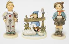 LOT OF 3 HUMMEL FIGURINES INCL CARNIVAL, FEATHERED FRIENDS, AND BROTHER. TALLEST IS 5 3/4 IN.