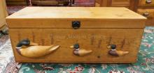 PINE BLANKET CHEST WITH 3 DIMENSIONAL WOODEN DUCKS ON THE FRONT. 35 IN WIDE.