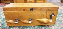 PINE BLANKET CHEST WITH 3 DIMENSIONAL WOODEN DUCKS ON THE FRONT. 36 IN WIDE.