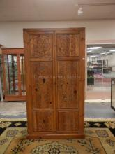 HENREDON LINEN PRESS WITH CARVED PANEL DOORS. SHELVES AND DRAWERS ON INTERIOR. 76 1/2 IN TALL. 40 1/2 IN WIDE.