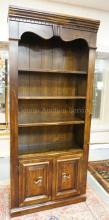 PINE BOOKCASE WITH CABINET BELOW. 78 IN TALL. 34 1/4 IN WIDE.
