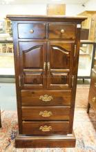 PENNSYLVANIA HOUSE PINE CABINET WITH LIFT TOP COMPARTMENT OVER 2 DOORS ORVER 3 DRAWERS. 52 IN TALL. 26 IN WIDE.