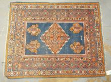 RARE ANTIQUE KAZAK W/WEAVER SIGNATURE. BLUES, REDS, ORANGE COLORS. 5 FT 4 IN X 4 FT 1 IN. SMALL EDGE LOSS OVERALL. EXCELLENT CONDITION.
