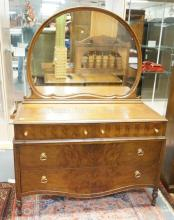MAHOGANY CHEST OF DRAWERS WITH MIRROR. TOP DRAWERS WITH MATCHBOOK VENEER. 49 1/2 IN WIDE. 68 IN TALL.