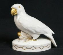 HUTSCHENREUTHER PORCELAIN PARROT FIGURE. 6 1/2 IN TALL.