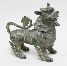 ORIENTAL BRONZE FOO DOG. 10 1/2 IN TALL.