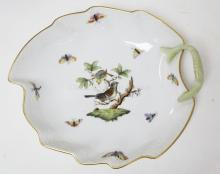 HEREND ROTHHILD PORCELAIN LEAF FORM DISH. BIRD CENTER WITH BUTTERFLIES AND A BASKETWEAVE BORDER. 8 IN X 7 IN.