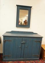 COUNTRY 2 DOOR CABINET & MIRROR IN BLUE PAINT. 46 1/2 IN WIDE. 35 IN TALL.