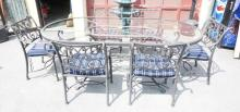 IRON PATIO TABLE & 6 ARMCHAIRS WITH CUSHIONS. 85 1/2 X 43 1/2 IN TOP.