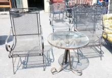 3 PIECES OF IRON PATIO FURN. 2 CHAIRS & A GLASS TOP TABLE MEASURING 25 IN DIA.