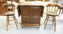 PINE BAR WITH 2 STOOLS. BACK HAS A 2 DOOR CABINET & DRAWER. 72 IN WIDE. 42 1/2 IN TALL.