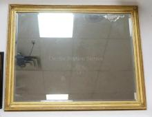 GOLD GILT MIRROR WITH BEVELED GLASS MEASURING 40 X 32 IN.