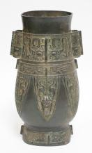 ASIAN BRONZE VESSEL MEASURING 12 1/4 IN TALL.