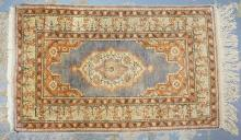 ORIENTAL THROW RUG. 3 FT 2 IN X 2 FT.