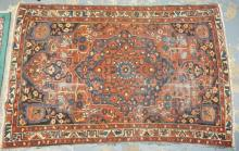 ANTIQUE HERIZ RUG. 6 FT 9 IN X 4 FT 5 IN.