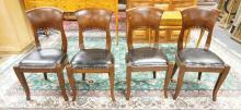 SET OF 4 WALNUT CHAIRS WITH LEATHER SEATS. 35 IN TALL.