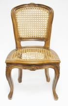 FRENCH CARVED WALNUT CHILDS CHAIR. CANE SEAT NEEDS REPAIR. 25 1/4 IN TALL.