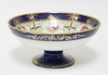 UNMARKED NIPPON BOWL HAND DECORATED WITH ROSES AND GOLD. 10 INCH DIA. 4 1/2 INCHES TALL.