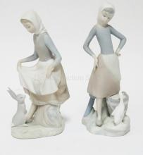 2 LLADRO PORCELAIN FIGURES. WOMAN WITH A RABBIT, THE OTHER WITH A DUCK. TALLEST IS 9 1/4 INCHES.