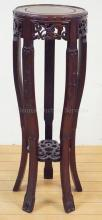 ORNATELY CARVED WOODEN STAND MEASURING 36 IN TALL AND 14 IN WIDE.