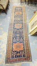 ORIENTAL RUNNER. 12 FT 6 INCHES X 3 FT 5 INCHES. HAS WORN SPOTS.