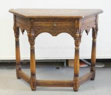 *FEUDAL OAK* CARVED OAK CONSOLE TABLE. 38 1/2 INCHES WIDE.