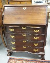 MAHOGANY SLANT FRONT DESK WITH SERPENTINE DRAWERS AND BALL & CLAW FEET. 29 1/2 INCHES WIDE. 41 INCHES TALL.