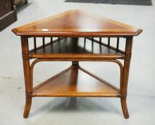 RATTAN & MAHOGANY CORNER TABLE. 24 INCHES TALL. 30 INCHES WIDE.