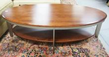 MODERN COFFEE TABLE. 29 X 56 INCHES OVAL.