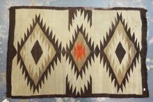 NAVAJO INDIAN RUG. HAS A STAIN. 5 FT 8 INCHES X 3 FT 9 INCHES.