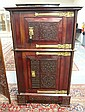 CARVED 2 DR CABINET W/FANCY BRASS HARDWARE