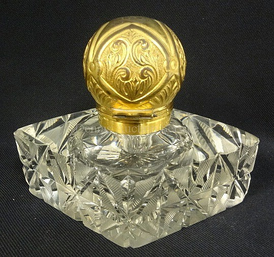 CUT GLASS DIAMOND SHAPED PERFUME BOTTLE W/BENJAMINS PATENTS DOUBLE HINGED GILT METAL TOP; NO STOPPER; 6 1/2 IN W, 5 IN H