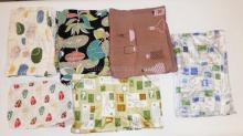 7 SMALLER PIECES MID C FABRIC INCL POSTAL MOTIF.