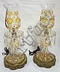 PR OF AMBER STAINED & CRYSTAL CUT & ENGRAVED HURRICANE LAMPS W/FANCY BRASS BASES; 19 3/4 IN H