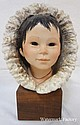 CYBIS BUST ESKIMO BOY W/FUR LINED HOOD, ON WOODEN