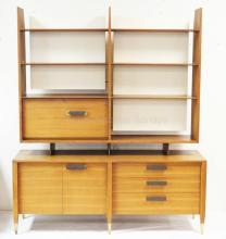 GIO PONTI 2 PC BACKLIT WALNUT DINING ROOM CABINET. TOP HAS 7 OPEN SHELVES, A FALL FRONT BAR SECTION W/ MILK GLASS LINING ON THE BACK OF THE DOOR AND IS BACKED WITH 2 WHITE PANELS. BASE HAS 3 DRAWERS AND 2 DOORS. 68 IN WIDE, 80 IN H, 19 IN DEEP. HAS