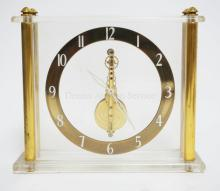 LECOULTRE SKELETON CLOCK IN LUCITE CASE. 6 1/4 WIDE. 5 1/4 IN TALL.