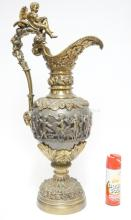 MONUMENTAL BRONZE EWER HEAVILY DECORATED WITH CHERUBS, CHARIOTS, FRUIT, ETC.. 33 11/4 IN TALL.