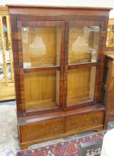 INLAID TIGER MAPLE BOOKCASE WITH GLASS DOORS AND 2 DRAWERS BELOW. 63 1/2 IN WIDE, 83 IN TALL