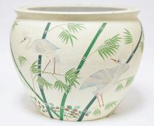 POTTER JARDINIERE WITH INCISED AND PAINTED DECORATION OF CRANES. 13 1/2 IN TALL.