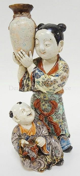 HAND PAINTED ORIENTAL FIGURE GROUP; WOMAN W/URN &