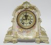 CHINA CASE CLOCK. ANSONIA WORKS W/OPEN ESCAPEMENT. 12 3/4 IN WIDE, 11 3/4 IN HIGH.