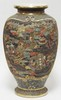 SATSUMA FLOOR URN W/RELIEF DECORATION OF PEOPLE, BUILDINGS, TREES, ETC. 21 1/4 IN H. CHARACTER SIGNED.