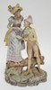 LARGE BISQUE FIGURE GROUP- LADY AND GENTLEMAN. HAND PAINTED. 16 3/4 IN H.