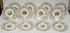 SET OF 12 COPELAND SPODE HAND PAINTED SERVICE PLATES. ARTIST SIGNED M. EDGE. 6 DESIGNS OF POLYCHROME FRUIT CENTER MEDALLIONS W/ GOLD FLORAL AND FRUIT BORDERS. 10 1/2 IN